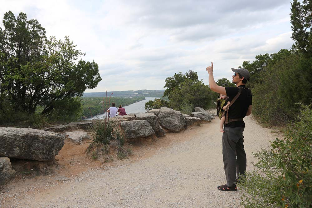 Mount Bonnell has plenty of places to relax and enjoy the view, here teaching my son about clouds.