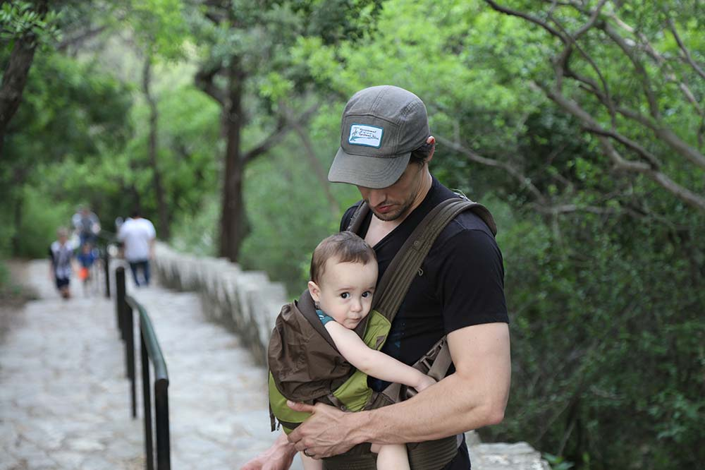 Mount Bonnell stair case - Tyler Garrett holding his son Andoni